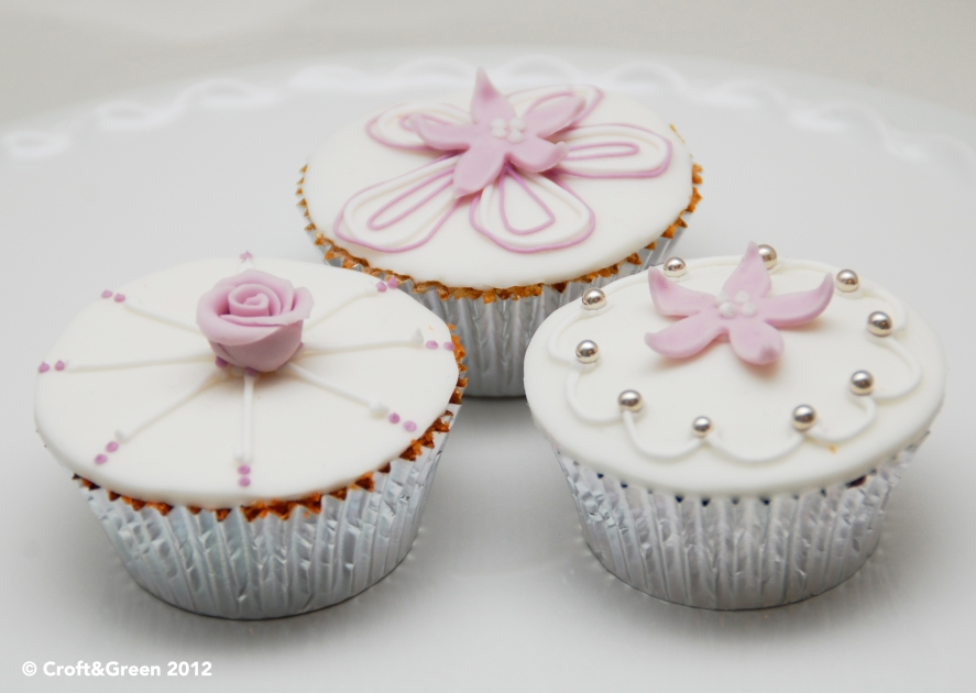 Vanilla wedding cupcakes with sugar icing and decoration